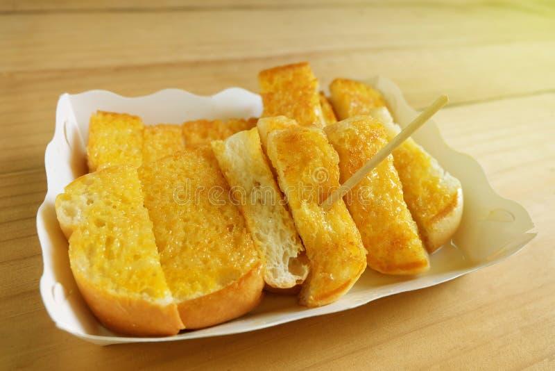 A margarina da propagação do brinde pôs o leite condensado Sweetened foto de stock