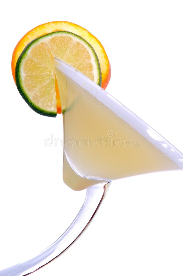 Margarita. High key image of a margarita with a slice of lime and a slice of orange royalty free stock image