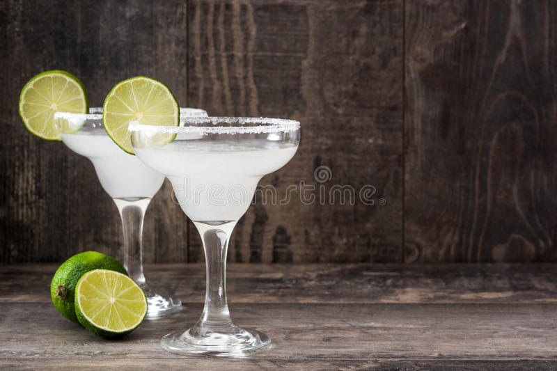 Margarita cocktails on a rustic wooden table royalty free stock photos