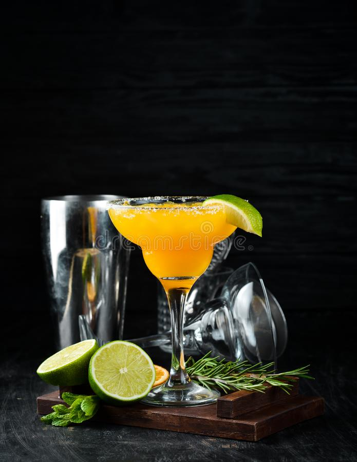 Margarita Mango. Alcoholic cocktail. On a wooden background. Top view. Free copy space royalty free stock image