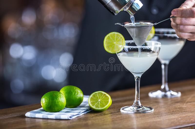 Margarita. Margatita alcoholic cocktail drink on barcounter in p stock image