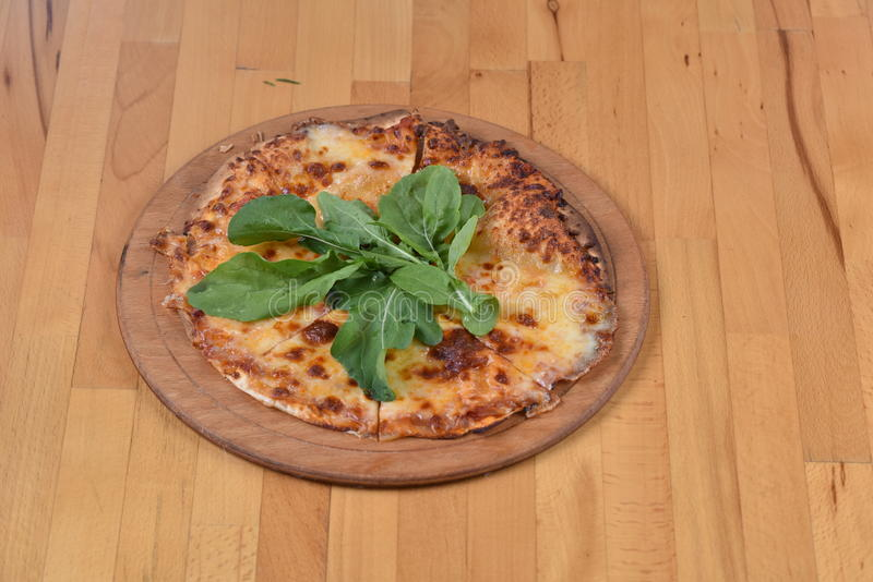 Margarita Pizza. Served on a wooden plate royalty free stock images