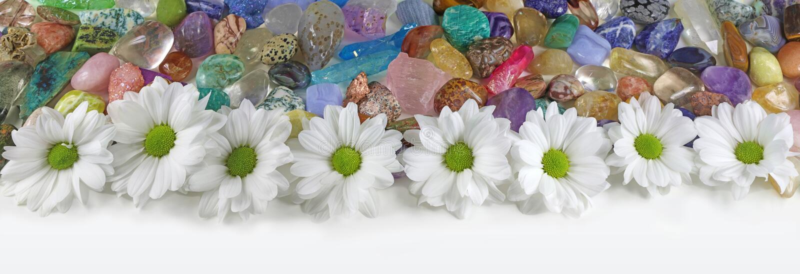 Margaritas y bandera curativa de los cristales fotografía de archivo