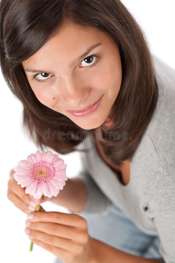 Marguerite de gerbera de fixation d'adolescent photos libres de droits