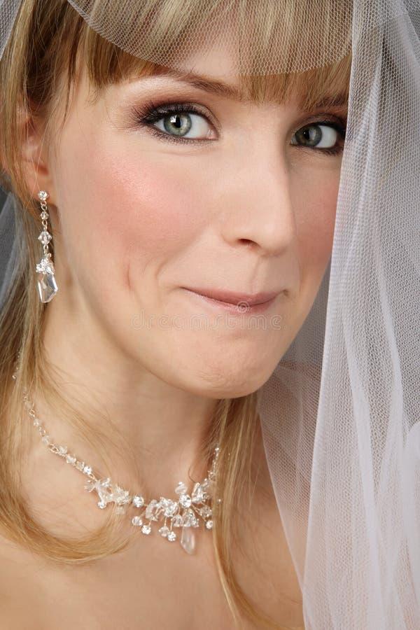 Mariée avec l'expression astucieuse photographie stock