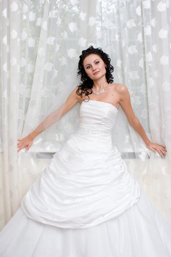 Mariée par l'hublot images libres de droits