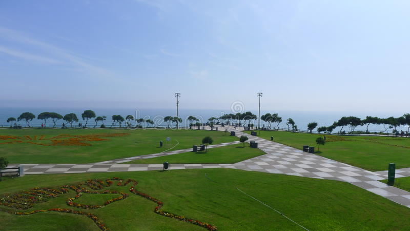 Maria Reiche park in Miraflores district of Lima. Scenic view of the Maria Reiche park in Miraflores district of Lima, Peru. A foot and a bird is designed with royalty free stock photo