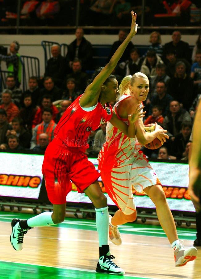 Maria Stepanova attacks against Dewanna Bonner. 01 February 2011 in Ekaterinburg, DIVS, (Russia) match EuroLeague 1/8 final game playoff UMMC vs RIVAS ECOPOLIS royalty free stock images
