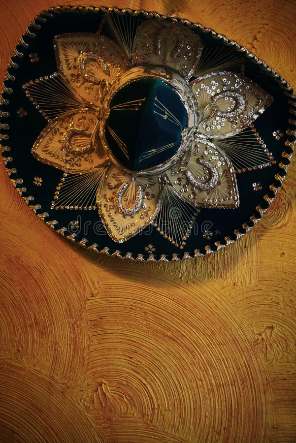 Mariachi sombrero hat with sequins on a orange wall stock photo