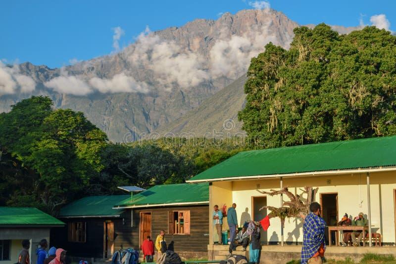 Mariakamba Hut Mount Meru, Arusha National Park. Hikers and Porters at Mariakamba Hut, Mount Meru, Arusha National Park, Tanzania royalty free stock image