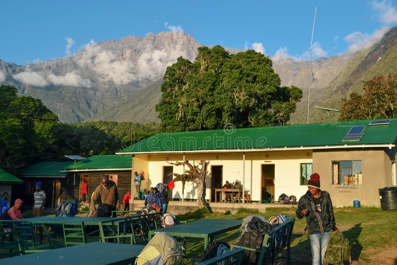 Mariakamba Hut Mount Meru, Arusha National Park. Hikers and Porters at Mariakamba Hut, Mount Meru, Arusha National Park, Tanzania stock images