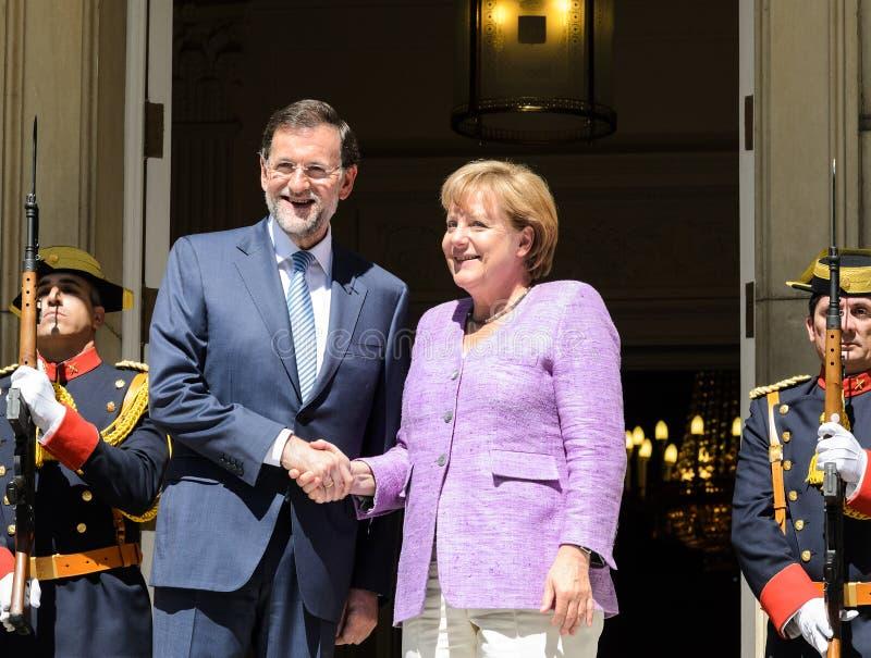 Mariano Rajoy en Angela Merkel royalty-vrije stock afbeeldingen