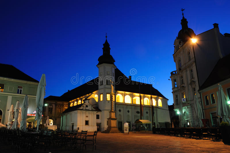 Maribor - Grajski Trg. View of Grajski Trg in Maribor with Castle and Statue of Saint Florian during Blue Hour royalty free stock photography