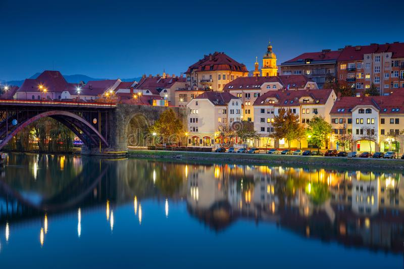 Maribor, Slovenia. Cityscape image of Maribor, Slovenia during autumn twilight blue hour with reflection of the city in Drava River stock images