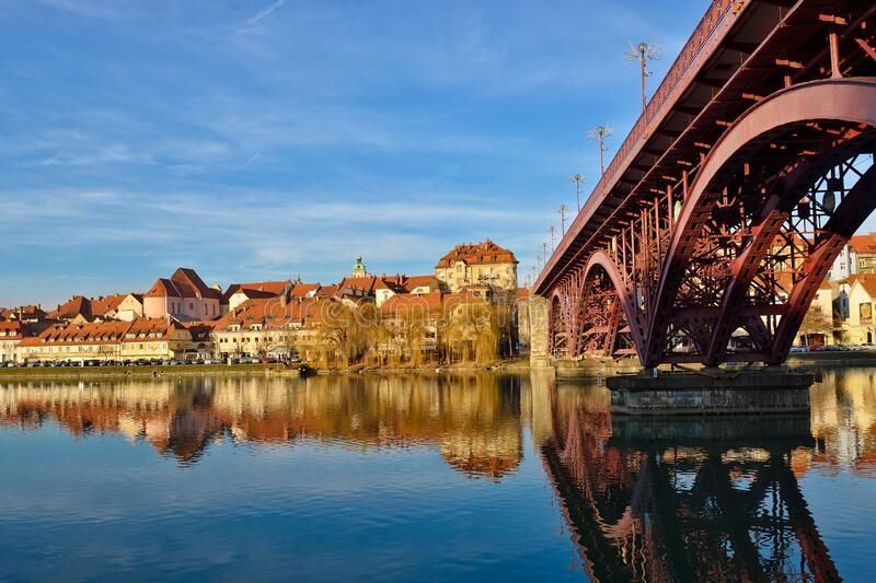 Maribor, Slovenia. Glavni Bridge over the River Drava. Leading to Maribors Old Town royalty free stock photography