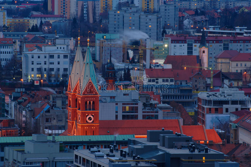 Maribor - View of the City. Maribor - view over city rooftops in the early winter morning with Franciscan Church in the center stock images