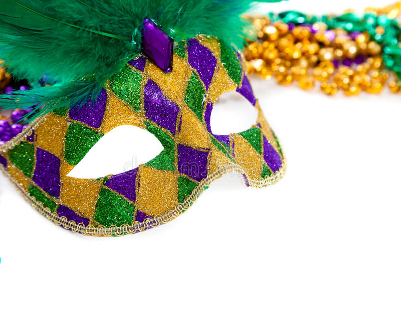 Marid Gras Mask and beads on white stock images