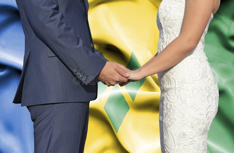 Marido y esposa que llevan a cabo las manos - fotograf?a conceptual del matrimonio en Saint Vincent y granadinas fotos de archivo