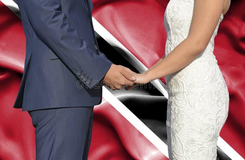 Marido y esposa que llevan a cabo las manos - fotograf?a conceptual del matrimonio en Trinidad and Tobago foto de archivo libre de regalías
