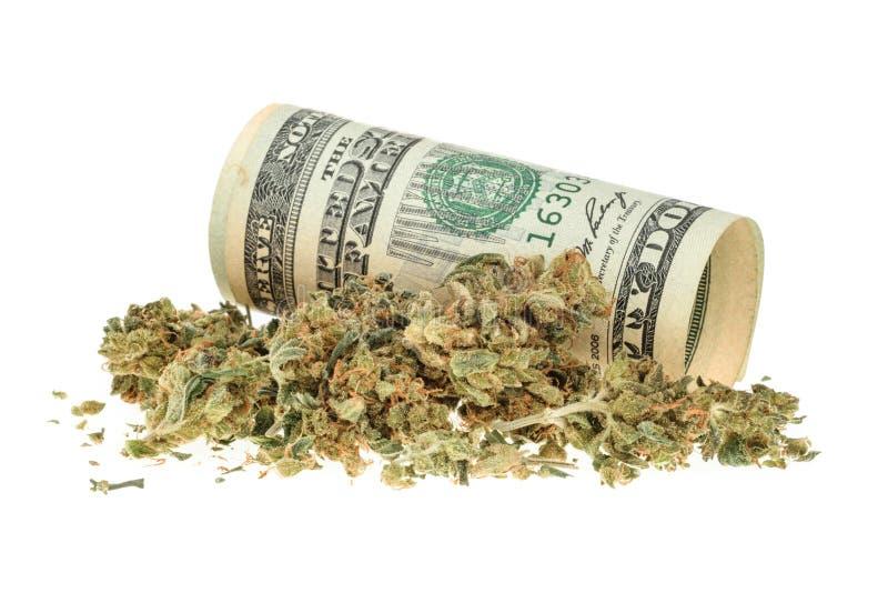 Marihuana en geld op wit wordt geïsoleerd dat royalty-vrije stock foto