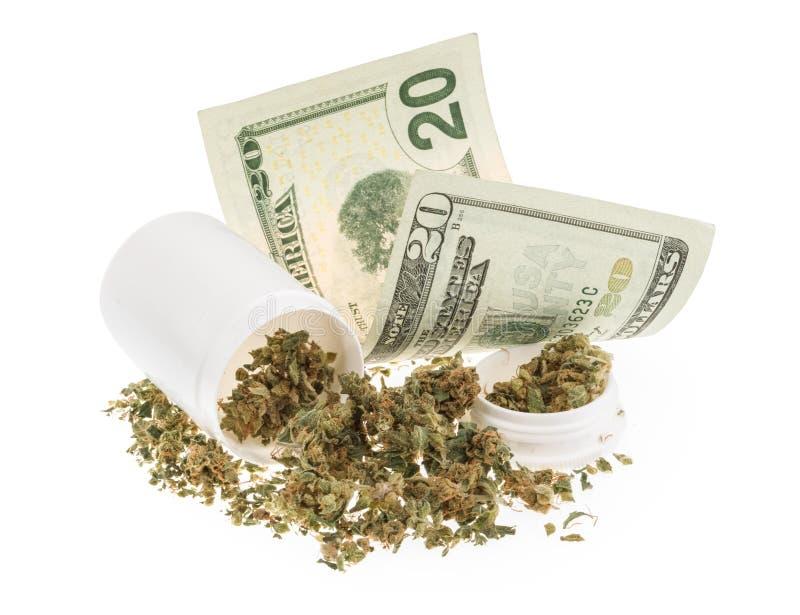 Marihuana en geld op wit wordt geïsoleerd dat stock afbeeldingen