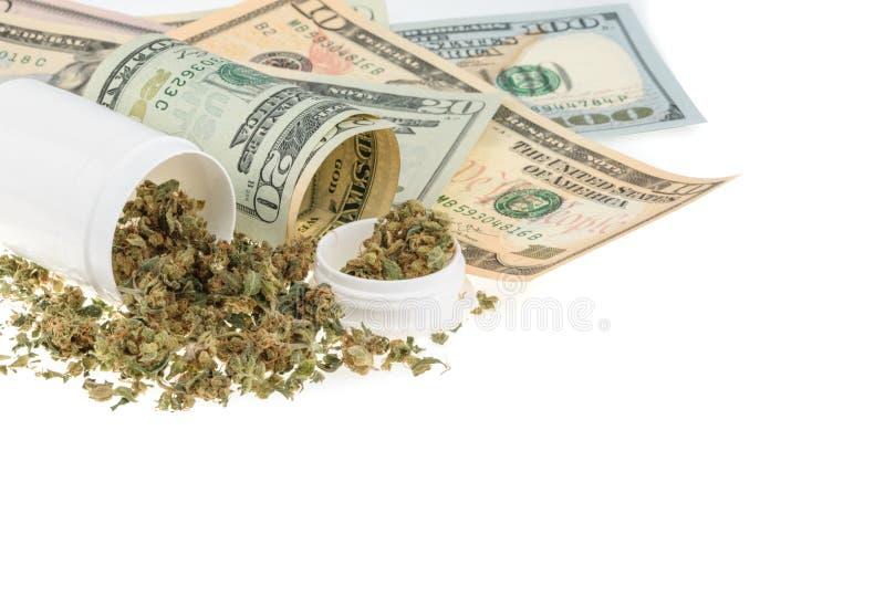 Marihuana en geld op wit wordt geïsoleerd dat stock foto's