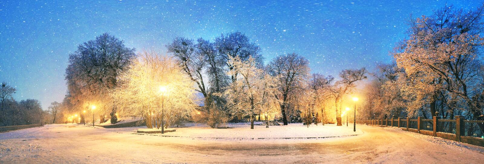 Mariinsky garden during inclement weather. Has its charm and Sharm glow lamps, soft snow- winding paths and roads - is a favorite place of citizens of the royalty free stock photography