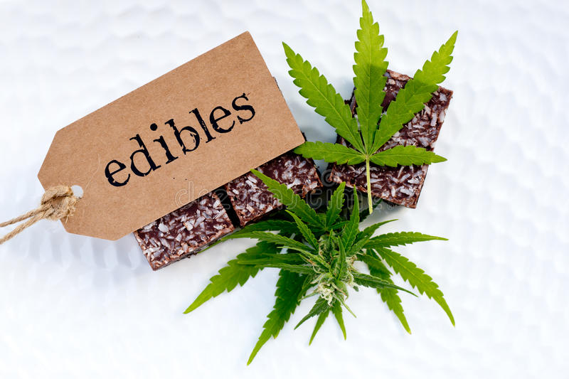 Marijuana - Cannabis - Medicinal Edibles - Coconut Brownies. With tag, leaf and bud royalty free stock photos