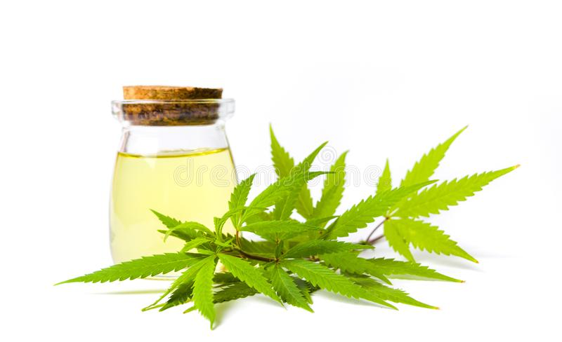 Marijuana and cannabis oil bottle isolated stock image