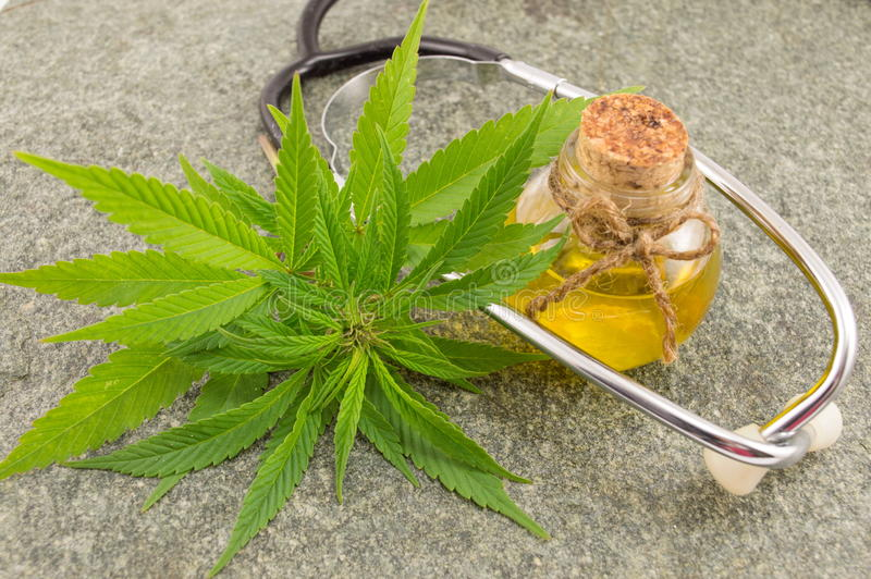 Marijuana, cannabis oil and stethoscope stock photography