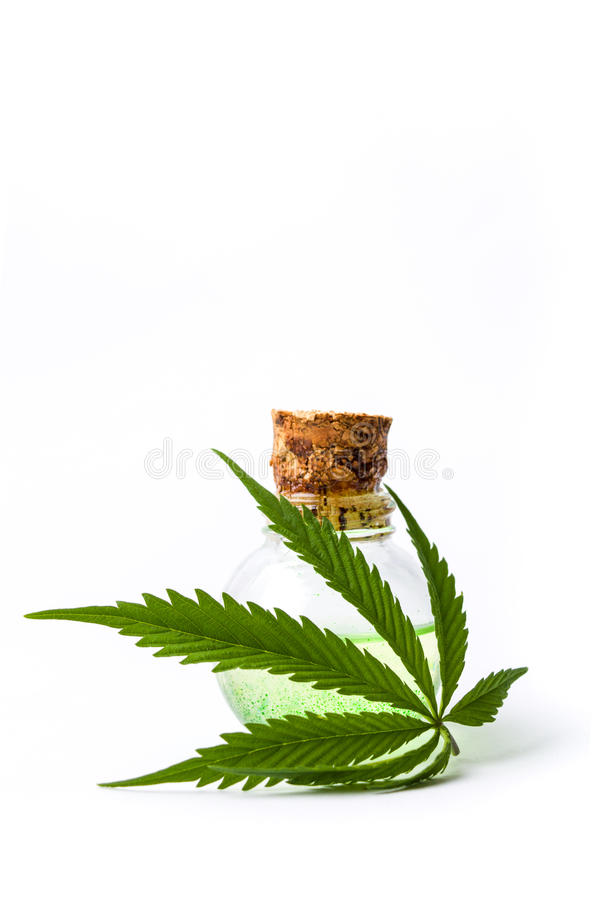 Marijuana leaf and cannabis oil bottles isolated royalty free stock images