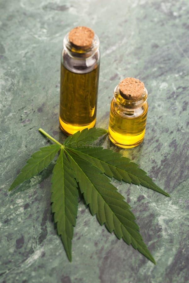 Marijuana plant and cannabis oil royalty free stock photo