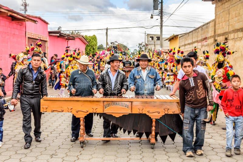 Marimba musicians & traditional folk dancers in street, Guatemala royalty free stock photography