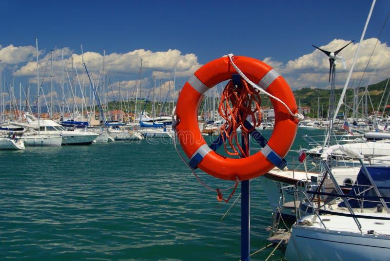 Marina. A red lifebelt in the Marina stock image