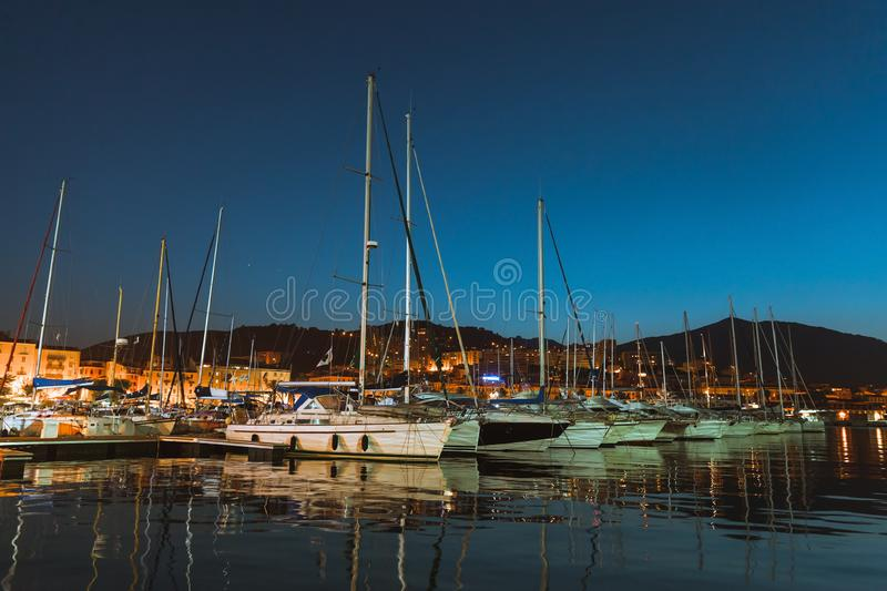 Marina of Ajaccio at dark night, Corsica. Pleasure sailing yachts and motor boats moored in port of Ajaccio at dark night, Corsica island, France royalty free stock image