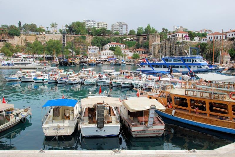 Marina Antalya with old town city walls. Marina with old town city walls with various ships Antalya city on the Mediterranean coast of southwestern Turkey royalty free stock photos