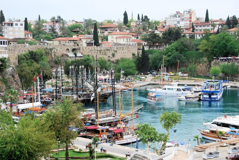 Marina Antalya with old town city walls. View of old Marina Antalya with old town city walls with various ships on the Mediterranean coast of southwestern Turkey stock photos