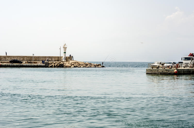 Marina bay of Antalya Turkey. The marina bay of Antalya Turkey in bright daylight with cars parked and sea front with fisherman royalty free stock photo