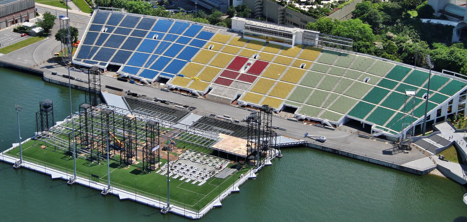 Marina Bay Floating Platform. Aerial view of the Marina Bay Floating Platform from Marina Bay Sands Skypark, with its coloured sectors visible. Photo taken on 17 royalty free stock photo