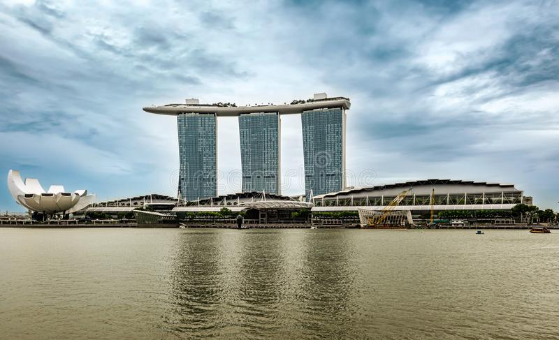 Marina Bay Sands hotel and Art Science museum downtown of Singap. Singapore - Jan 14, 2018: Futuristic architecture design Marina Bay Sands hotel and flower royalty free stock images