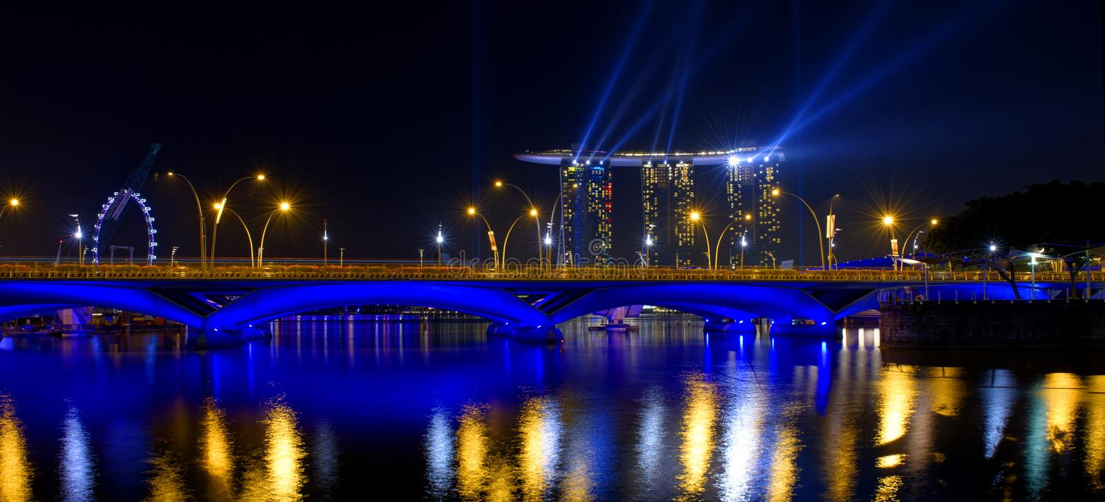 Marina Bay Sands hotel and Singapore Flyer. The Ferris wheel in Singapore royalty free stock photography