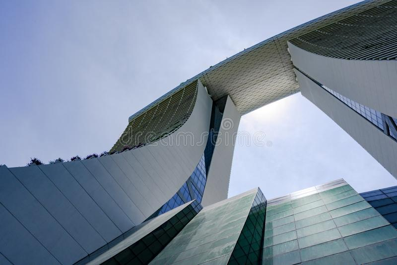 Marina Bay Sands Hotel, Singapore. View from bottom of two towers to rooftop of Marina Sands luxury Hotel. Las Vegas Sands build this luxury Hotel with the world stock image