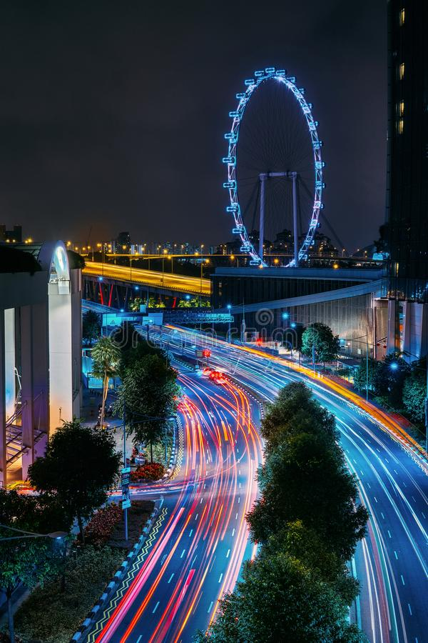 Marina Bay Sands Singapore And Ferris wheel, beautiful car taillights royalty free stock images