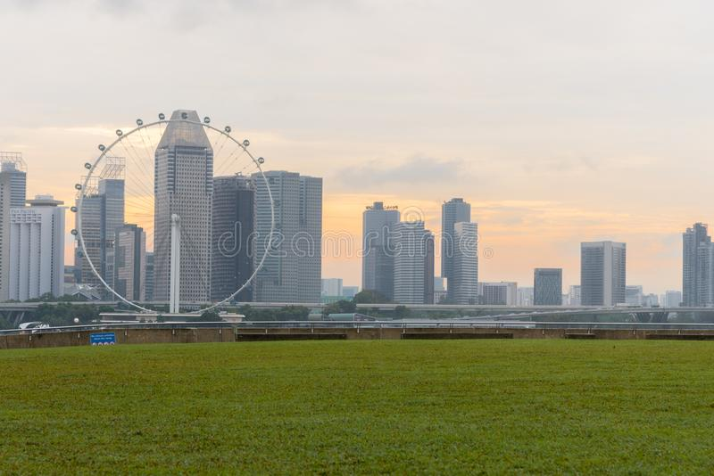 MARINA BAY SANDS, SINGAPORE - May 23, 2017: Singapore Flyer view. From Marina Barrage on sunset time at Marina Bay Sands Singapore royalty free stock photo