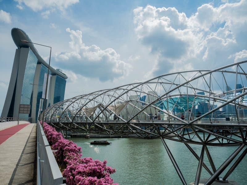 MARINA BAY - SINGAPORE, 24 NOV 2018: The Helix Bridge, Tourist walking on the Marina Bay Sands promenade in Singapore stock image