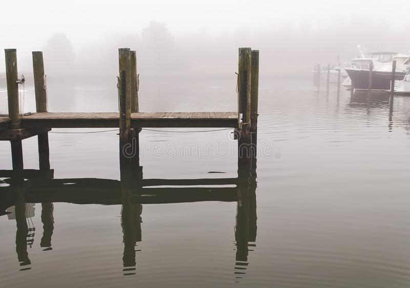 Maryland Marina Dock In Water With Reflection And Fog Stock