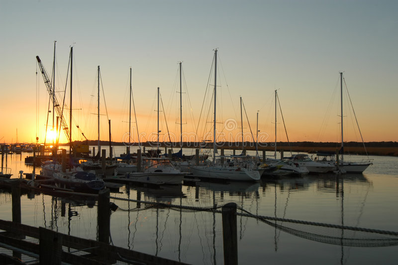 Marina boats at sunrise with blue sky royalty free stock image