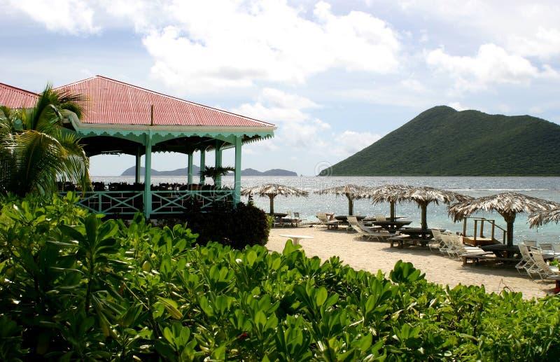 Marina Cay island scenic. Idyllic tropical resort with parasols on beach, Marina Cay island, British Virgin Islands stock photography