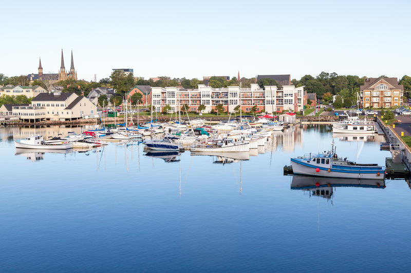 Marina and Church in Charlottetown. Small fishing boats in a calm blue harbor on Prince Edward Island in Canada stock photo