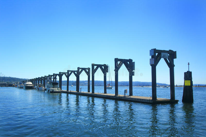 Marina Guest Moorage Dock. A side view of the moorage dock detail for guests and visitors boats in the Port of Everett Washington Marina in Puget Sound WA. A stock photo